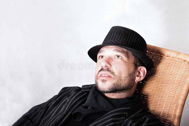 Bearded Man With Pierced Ear In Black Hat stock photo