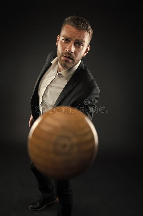 Bearded man point baseball bat. Businessman threaten with bat weapon. Aggression concept. ambitions and violence concept. Business fashion and style stock photos