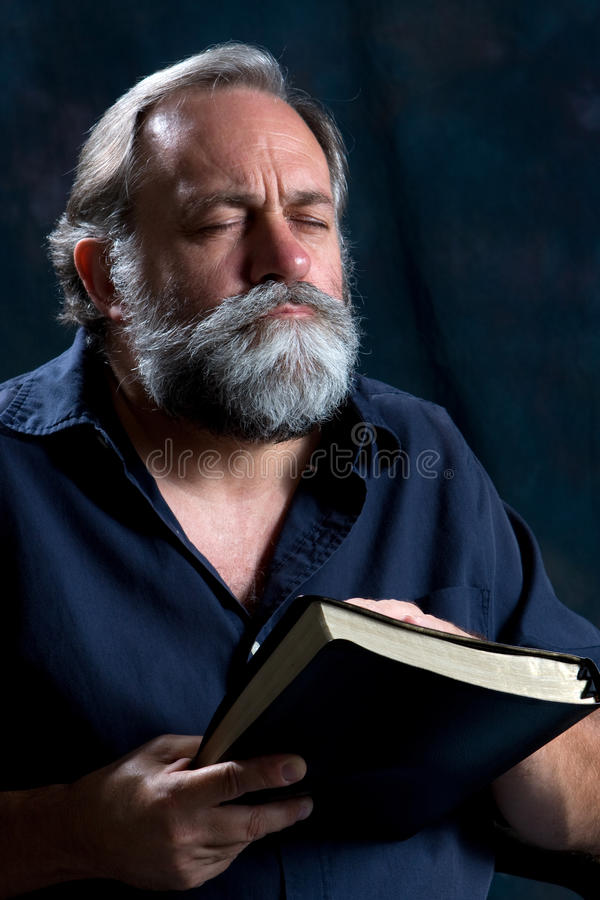 Bearded Man Praying royalty free stock images