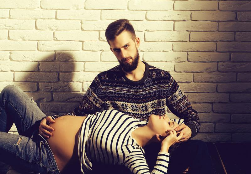 Bearded man and pretty pregnant woman with round belly royalty free stock photos
