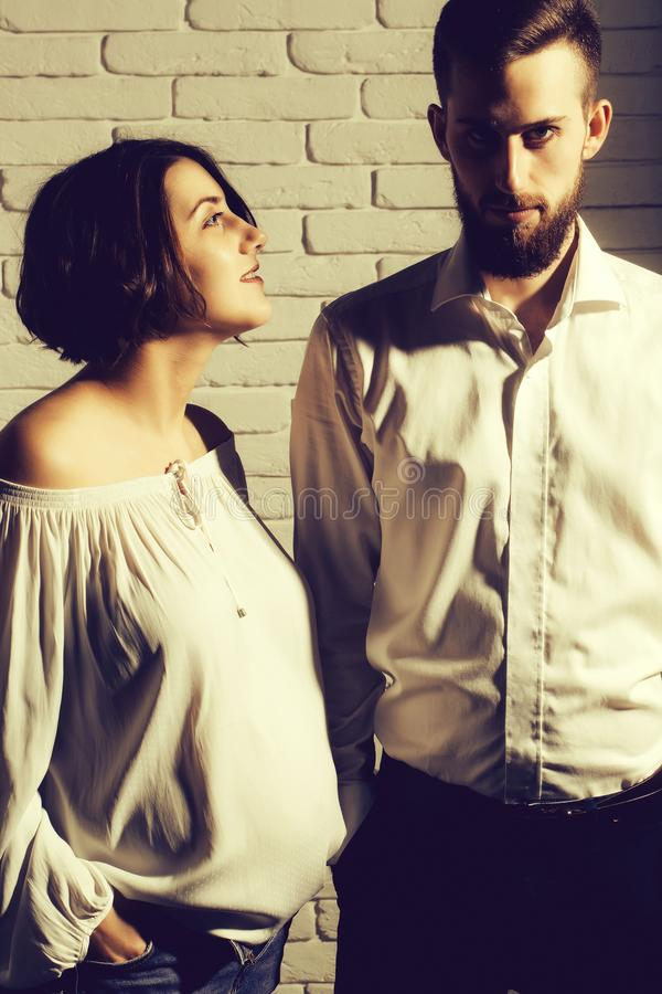 Bearded man and pretty pregnant woman with round belly stock images