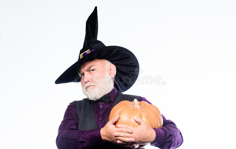 Bearded man ready for halloween party. happy halloween. evil wizard hold orange pumpkin. mature man magician in witch stock photos