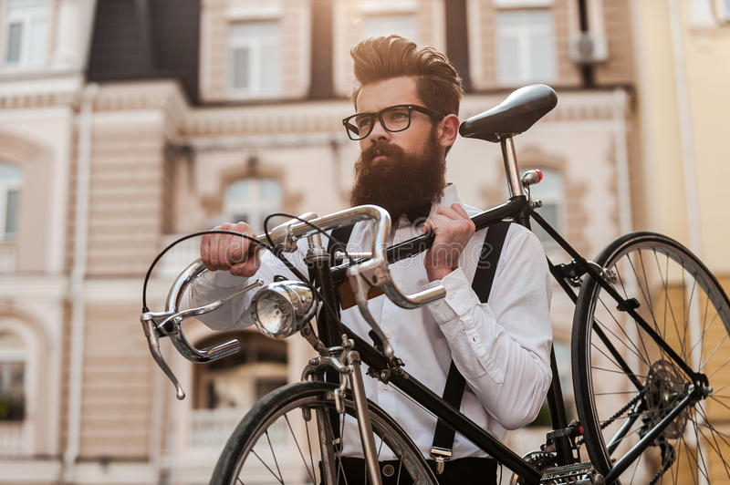 Bearded man with retro bicycle. stock image