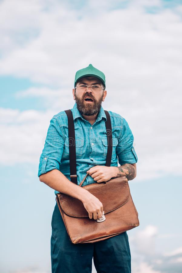 Bearded man with retro briefcase. Mature hipster with beard. Brutal male. Vintage fashion bag. Bearded man. Going to stock photos