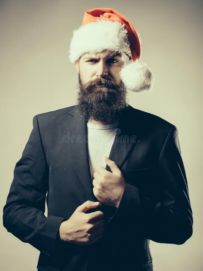 Bearded man in santa claus hat stock photos