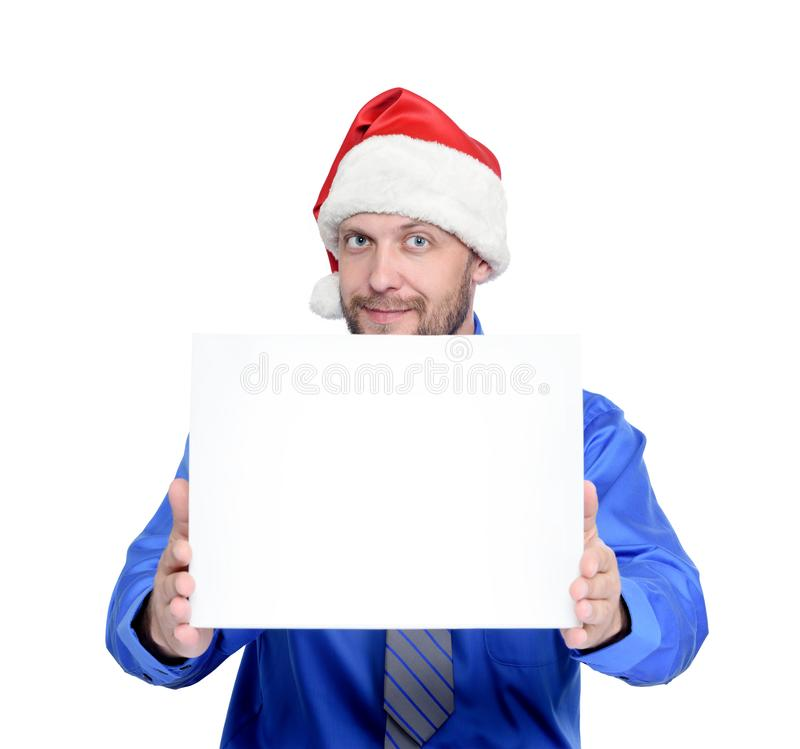 Bearded man in Santa Claus hat holds out white bag with gifts, isolated on white background. royalty free stock photo