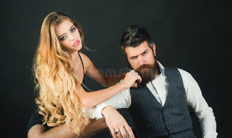 Bearded man and sexy woman with long curly hair. royalty free stock image