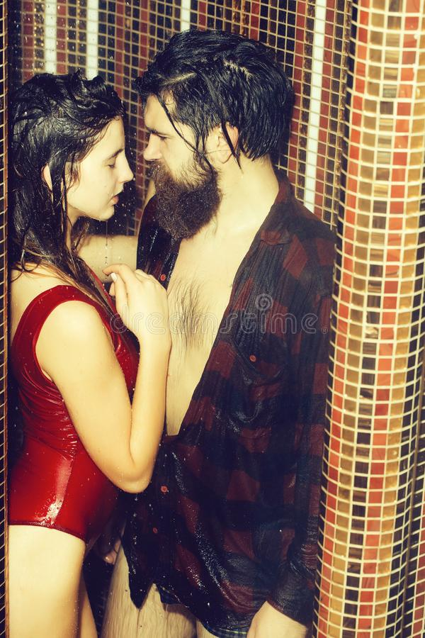 Bearded man and sexy woman in shower under water royalty free stock image