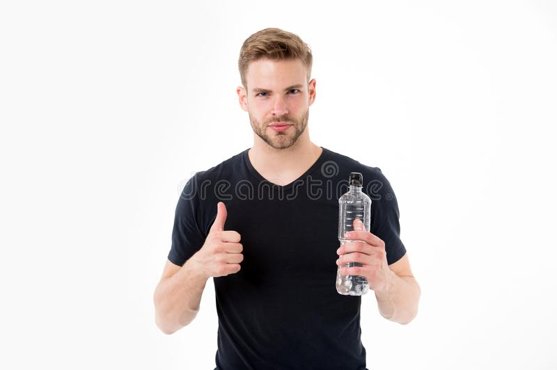 Bearded man show thumbs up with bottle of water. Thirsty man with beard in tshirt hold plastic bottle. Thirst and. Dehydration concept. Drinking water for royalty free stock images