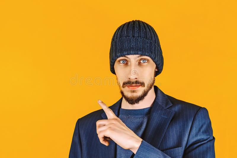 Bearded man shows his finger stock photo