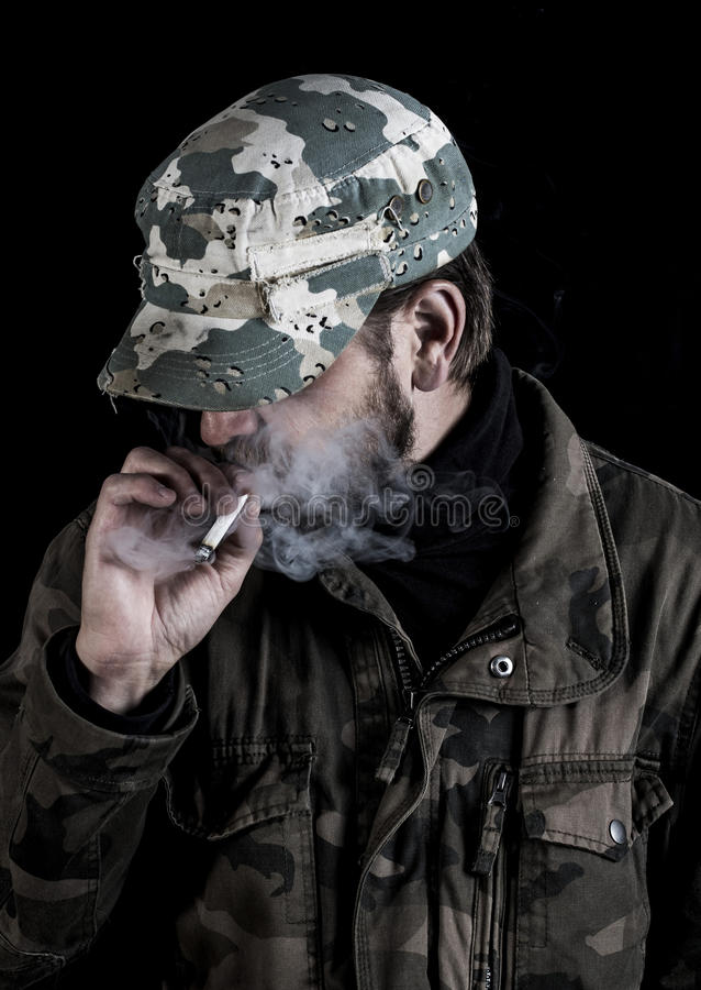 Bearded man smokes a cigarette in Finland. stock photos