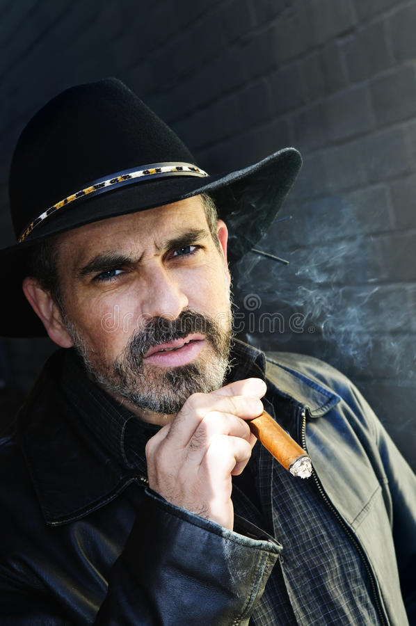Download Bearded man smoking cigar stock photo. Image of cowboy - 10929534