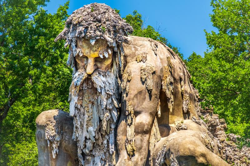 Bearded man statue colossus of Appennino giant statue public gardens of Demidoff Florence Italy close up royalty free stock images