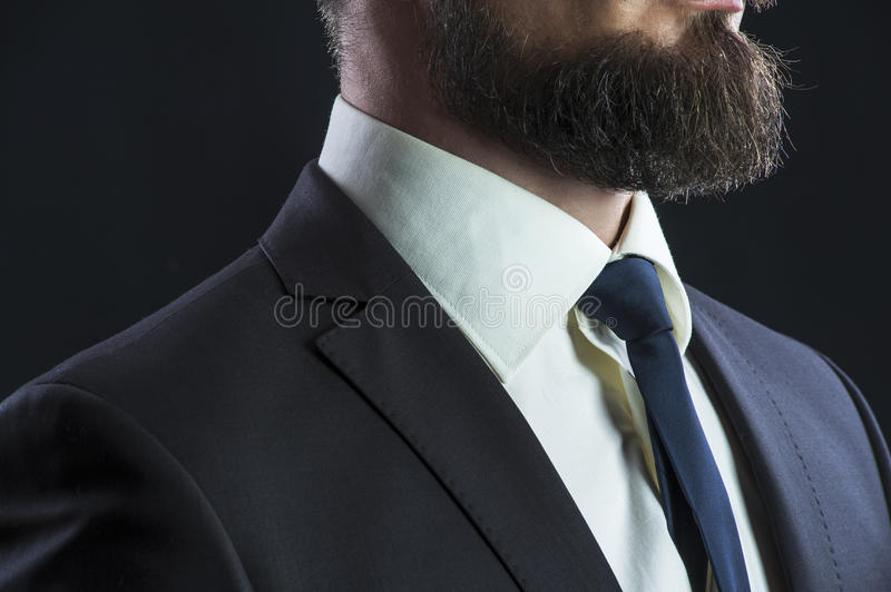 Bearded man in suit royalty free stock photography