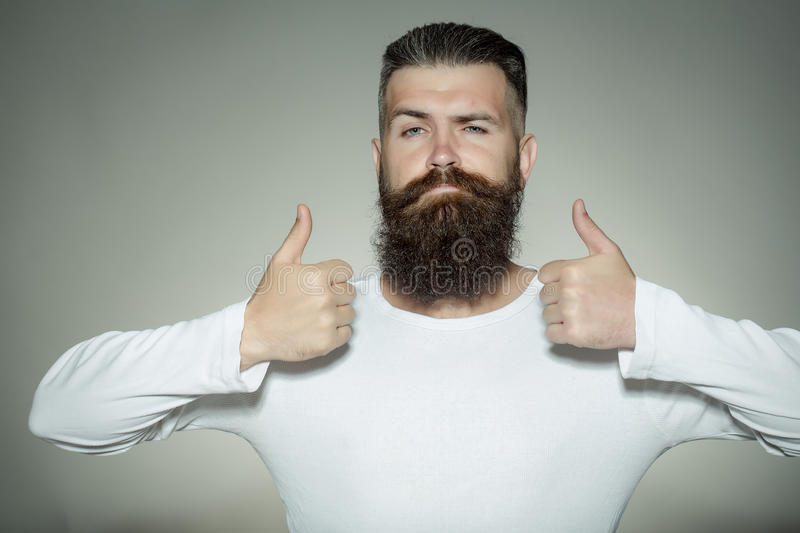 Bearded man with super gesture royalty free stock photography