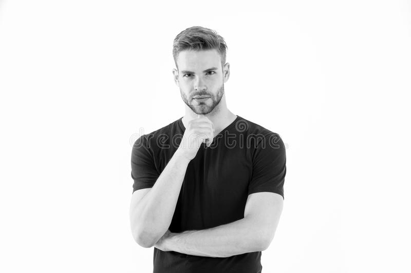 Bearded man touch beard with hand. Man with stylish hair and healthy young skin. Guy with unshaven face and mustache stock photography