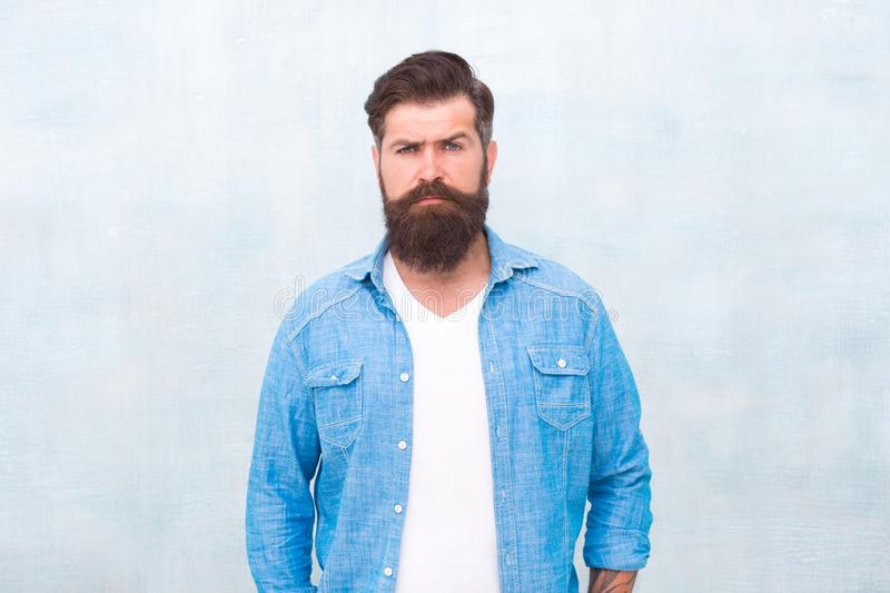 Bearded man trendy hipster style. Masculinity and male beauty concept. Hipster with beard and mustache wear denim shirt. Well groomed macho. Brutal handsome royalty free stock images
