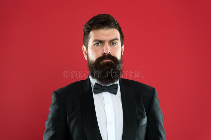 Bearded man in tuxedo and bow tie. Formal event. bearded man groom with beard in wedding suit. Businessman in tailored stock images