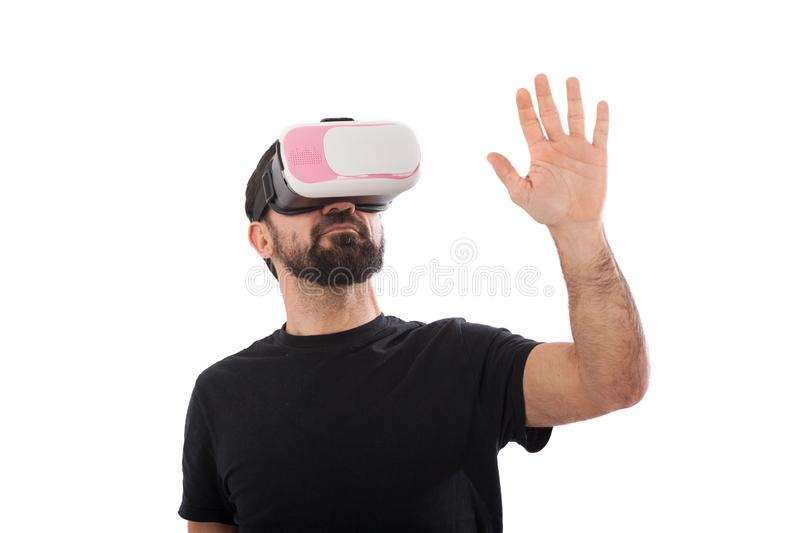 Bearded man use virtual reality glasses, goggles. Isolated. Guy in VR headset is looking at interactive screen. Playing mobile. Bearded man use virtual reality royalty free stock images