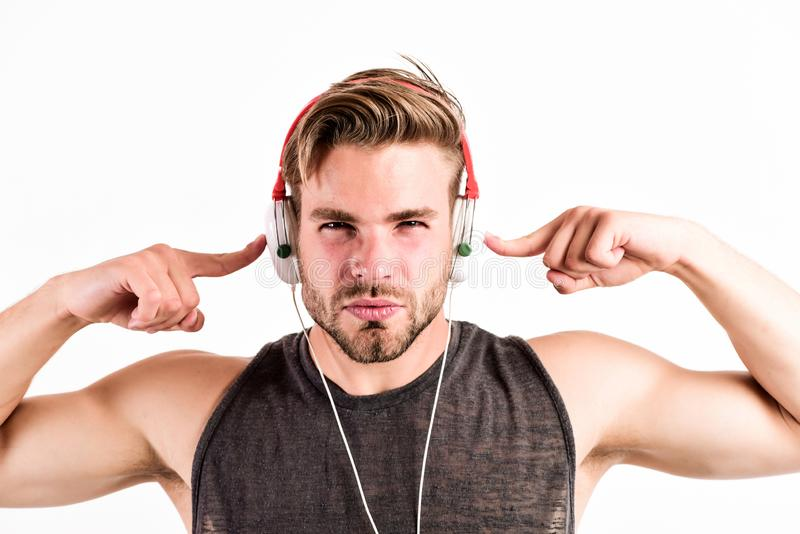 Bearded man wearing adjustable headset. relax playlist. sexy muscular man listen music from playlist. man relax in stock photos