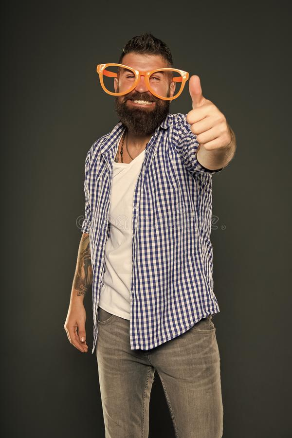 Bearded man wearing party glasses. Funny hipster in extravagant glasses. Fashion man with beard. Playful guy enjoying stock images