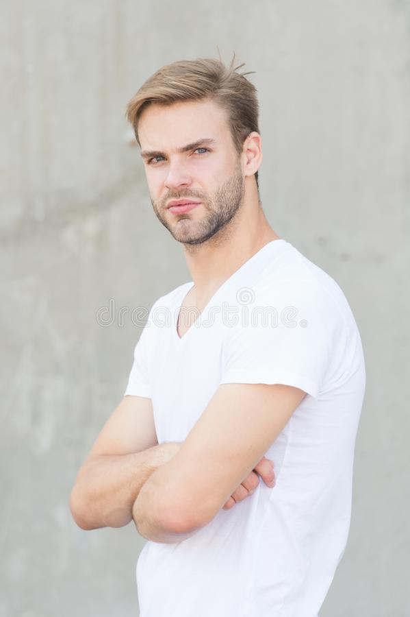 Bearded man white shirt. portrait of male attractiveness. young sexy guy gray background. confident macho man. summer royalty free stock photo