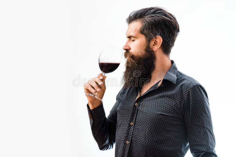 Bearded man with wine stock photos