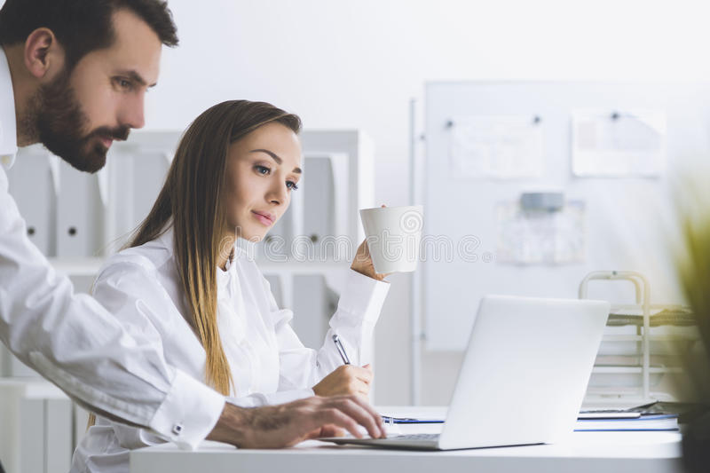 Download Bearded Man And A Woman In An Office, Side View Stock Image - Image of notebook, modern: 83722207