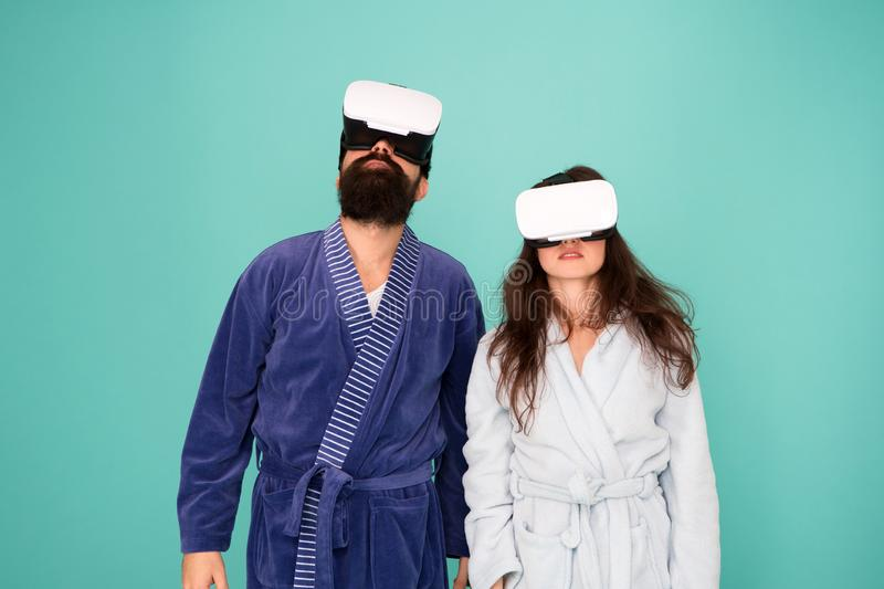 Bearded man and woman in robe. Couple in love. Family. Virtual reality and 3d. Love. modern family in vr glasses. 3d royalty free stock photos