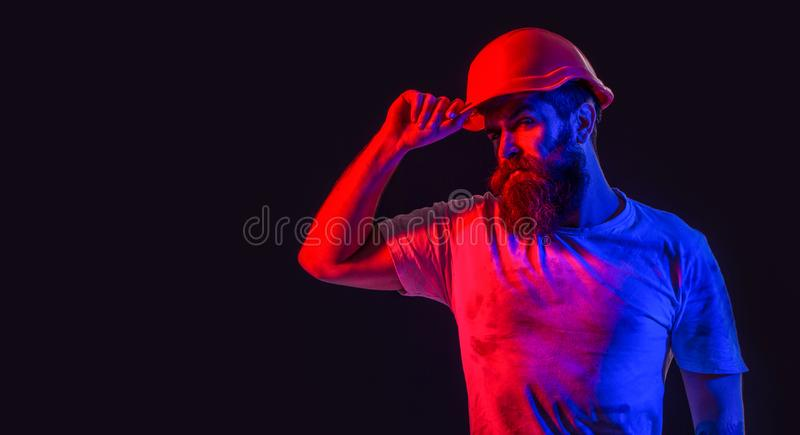 Bearded man worker with beard in building helmet or hard hat. Man builder, industry, technology, builder concept stock photo