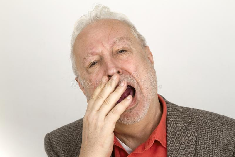 Bearded man yawning stock photos