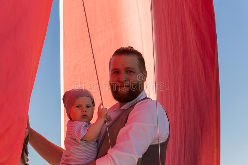 Man with a child on a sailing ship royalty free stock photo