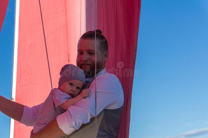 Man with a child on a sailing ship stock images