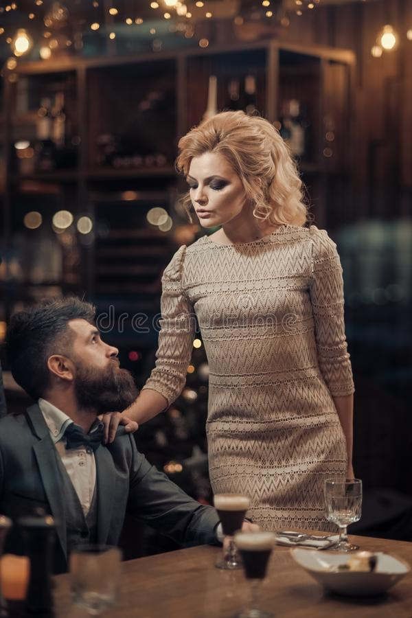 Bearded man and woman in elegant dress in restaurant. bearded man on date with girl. royalty free stock images