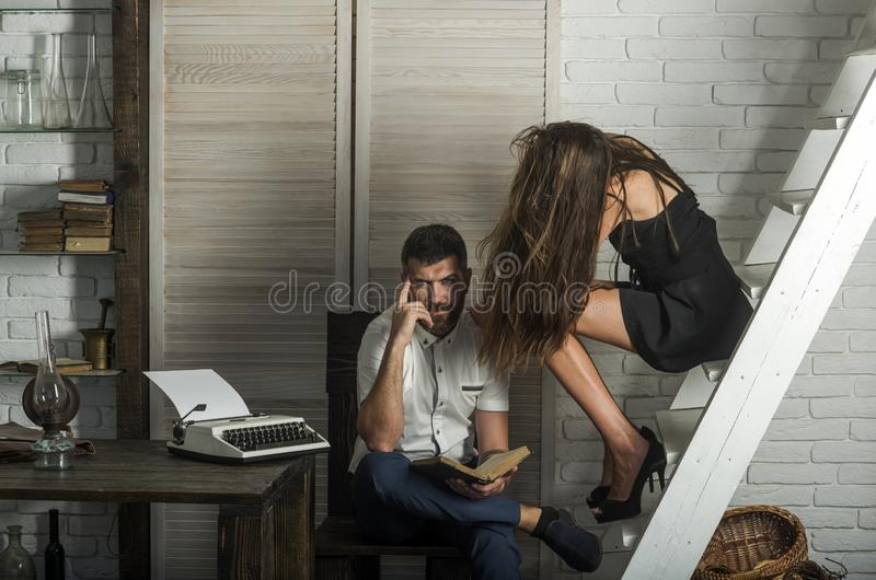 Bearded man and sexy woman on ladder royalty free stock image
