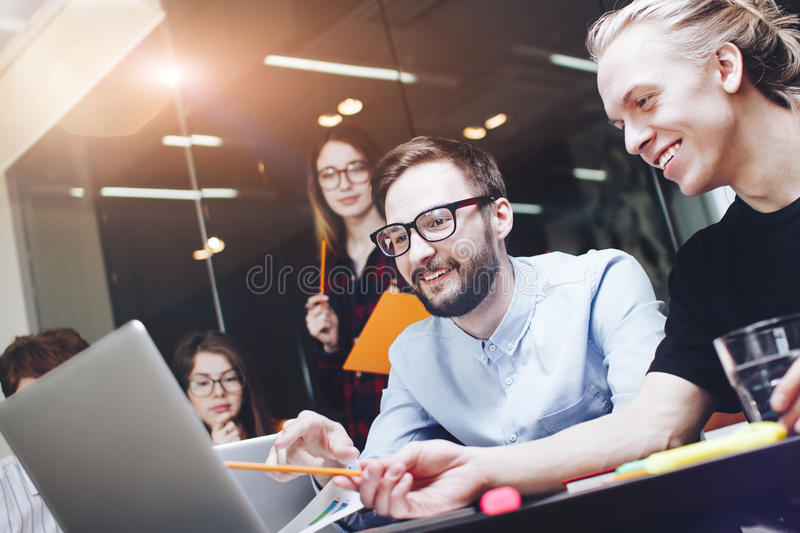Bearded man talking with colleague about new startup project. Jo stock images