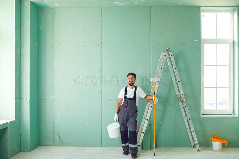 Bearded painter construction worker on a construction site. stock photography