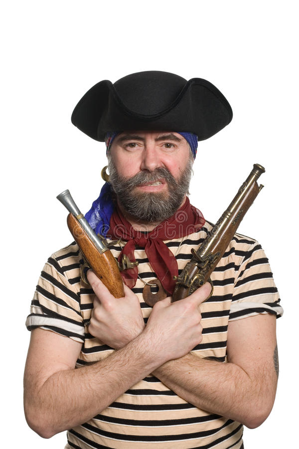 Bearded pirate in tricorn hat with a muskets. Terrible bearded pirate in tricorn hat with a muskets royalty free stock image