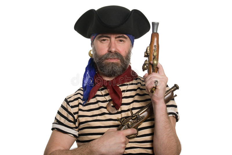 Bearded pirate in tricorn hat with a muskets. Terrible bearded pirate in tricorn hat with a muskets royalty free stock images