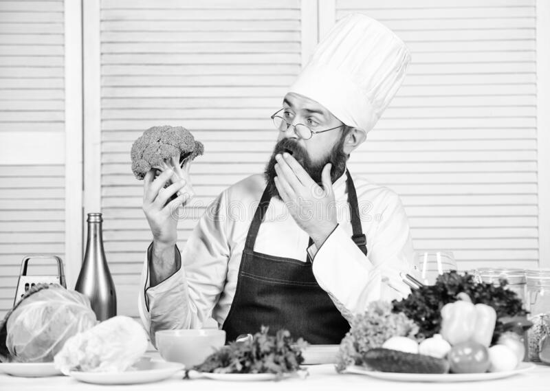 Bearded professional chef cooking healthy food. Healthy vegetarian recipe. Organic vegetables. I choose only healthy stock image