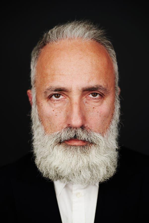 Bearded senior man in formal wear royalty free stock photos