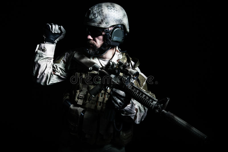 Bearded special forces soldier. On dark background royalty free stock image