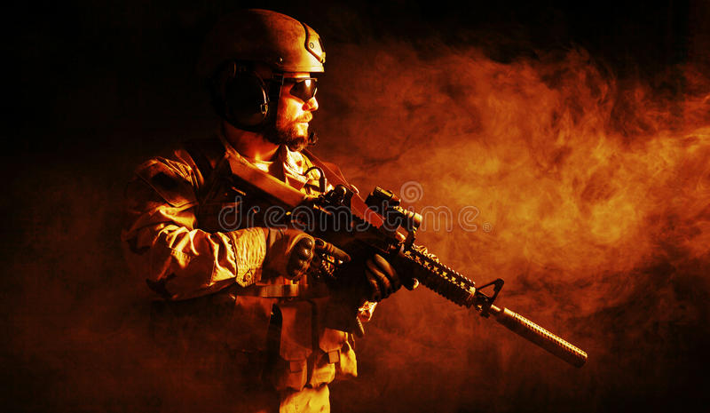 Bearded special forces soldier. In the fire stock image
