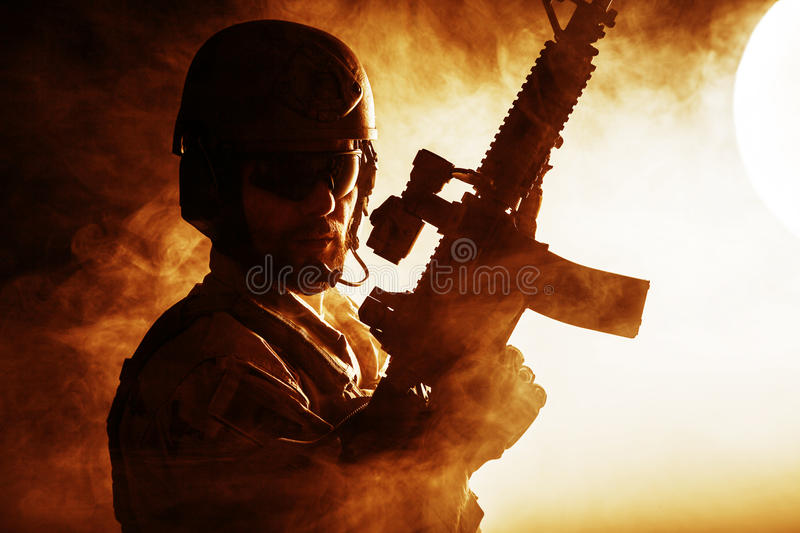 Bearded special forces soldier. In the fire royalty free stock photos