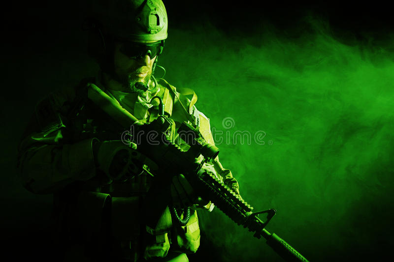 Bearded special forces soldier. In the smoke stock photography
