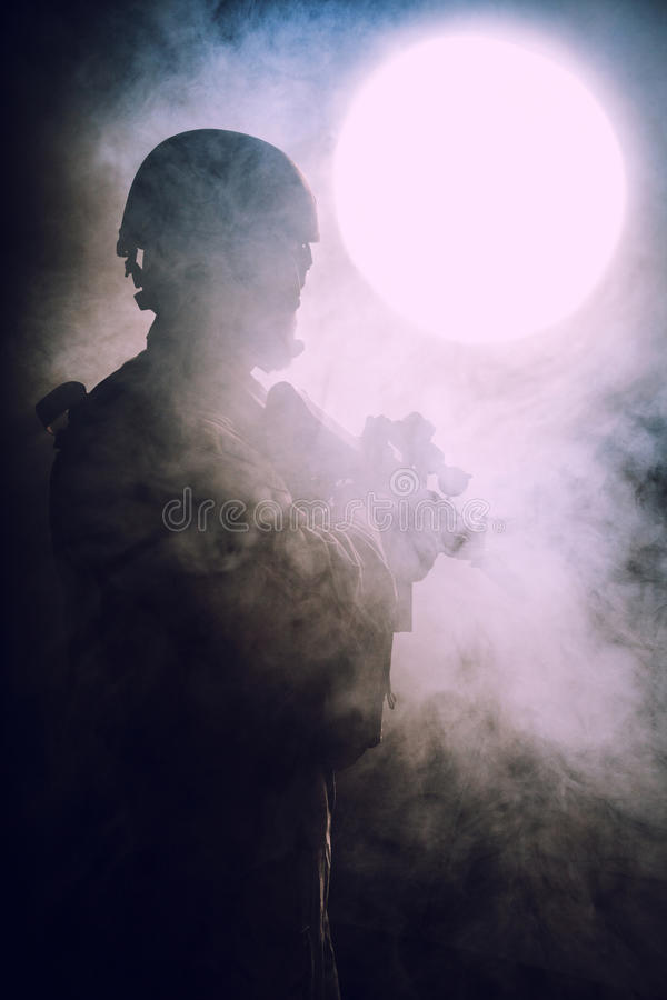 Bearded special forces soldier. In the smoke royalty free stock photography