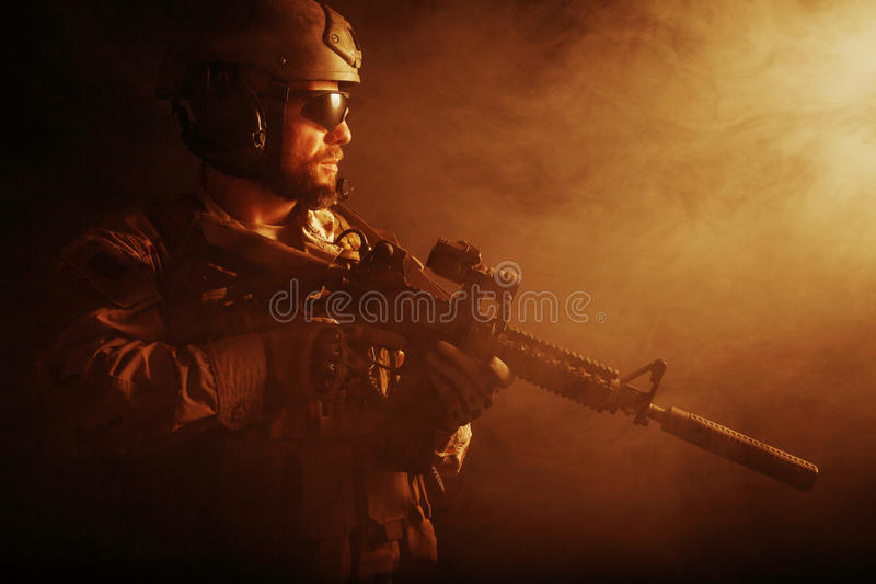 Bearded special forces soldier. In the smoke royalty free stock photo