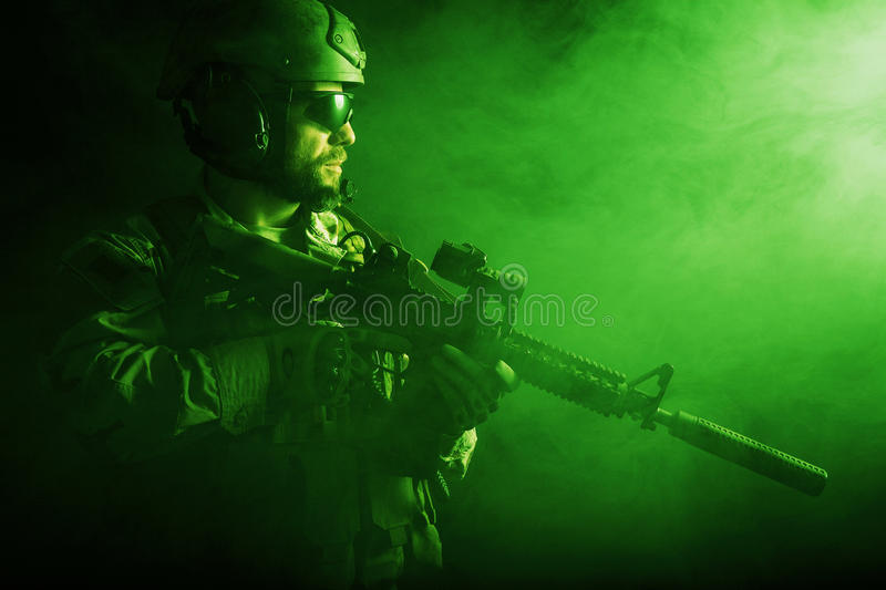 Bearded special forces soldier. In the smoke stock images
