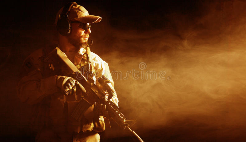 Bearded special forces soldier. In the smoke royalty free stock photos