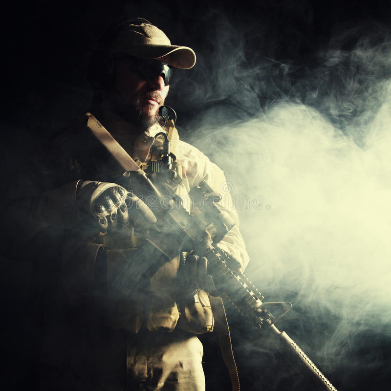 Bearded special forces soldier. In the smoke stock photo